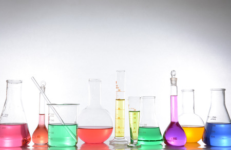 hypothesis: glass laboratory apparatus with color water Stock Photo
