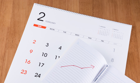 flicking: Notebook and pen on a calendar Stock Photo