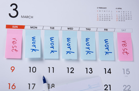 flicking: Label with work and rest on a calendar