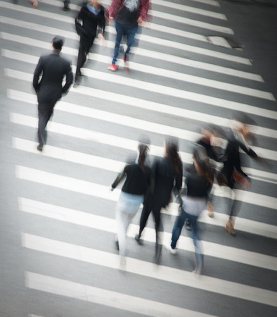 Busy city street people on zebra crossing Stock Photo
