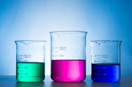 forensics: glass laboratory apparatus with color water Stock Photo