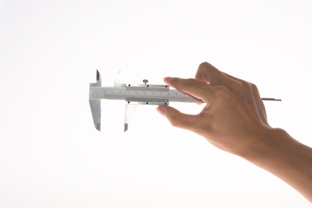 a hand have a caliper on white background Stock Photo