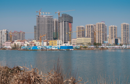 Buildings under construction by the river
