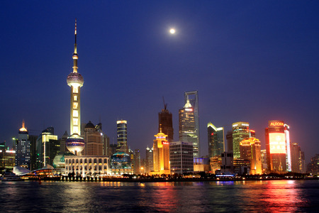 oriental pearl tower: As night fell, the Shanghai Pudong New Area brilliantly illuminated. As the moon rises, and the Oriental Pearl Tower echo each other at a distance, showing the international metropolis Shanghai prosperity