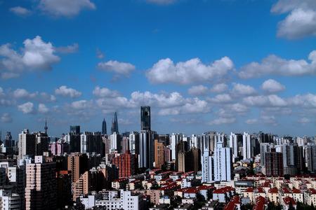 thriving: The great Shanghai  Chinese Shanghai, high-rise buildings, modern atmosphere rich, showing a thriving sceneinternational financial metropolis