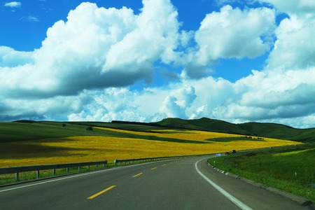 Grassland channel  In the blue sky and white clouds grass big channel, the vast grassland, and the sheep andMongolia sheep Chinese tiny spots, we in Inner Mongolia Hulun Buir Grassland channel flat wide driving, a beautiful picture from the eyes