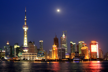 brilliantly: The moon hangs high  As night fell, the Shanghai Pudong New Area brilliantly illuminated, Ambilight, when the moon rises and the Oriental Pearl Tower echo each other at a distance, showed the international metropolis Shanghaiprosperity  Editorial