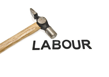cropped: image concept old and dirt cropped  hammer placed on left word labour isolated white background