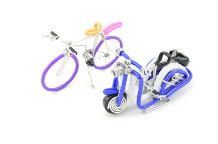solid wire: wired purple miniature bicycle and blue scooter placed side by side isolated white background