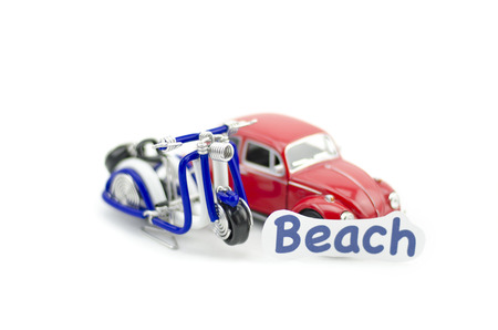 collectible: KUALA LUMPUR, MALAYSIA 17 AUGUST 2015 : image with word beach printed on paper. Volkswagon Beetle collectible model car and wired handcraft scooter. Editorial