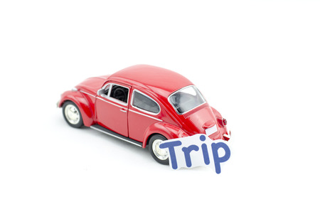 collectible: KUALA LUMPUR, MALAYSIA 17 AUGUST 2015 : image concept,word trip printed on paper attached  to the Volkswagon Beetle collectible model car