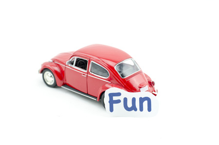 collectible: KUALA LUMPUR, MALAYSIA 17 AUGUST 2015 : image concept,word fun printed on paper attached  to the Volkswagon Beetle collectible model car Editorial