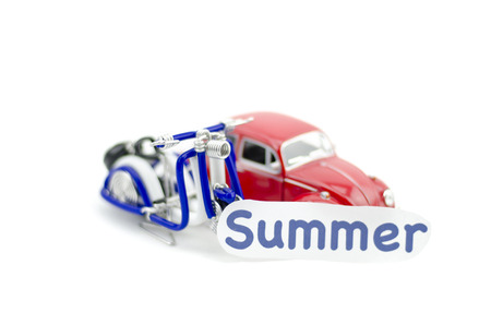 collectible: KUALA LUMPUR, MALAYSIA 17 AUGUST 2015 : image with word summer printed on paper. Volkswagon Beetle collectible model car and wired handcraft scooter.