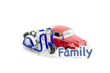 collectible: KUALA LUMPUR, MALAYSIA 17 AUGUST 2015 : image with word family printed on paper. Volkswagon Beetle collectible model car and wired handcraft scooter.