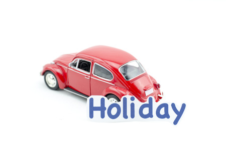 collectible: KUALA LUMPUR, MALAYSIA 17 AUGUST 2015 : image concept,word holiday printed on paper attached  to the Volkswagon Beetle collectible model car