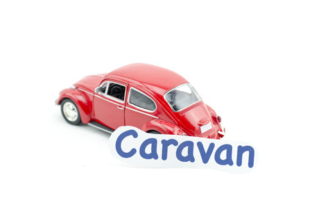 collectible: KUALA LUMPUR, MALAYSIA 17 AUGUST 2015 : image concept,word caravan printed on paper attached  to the Volkswagon Beetle collectible model car