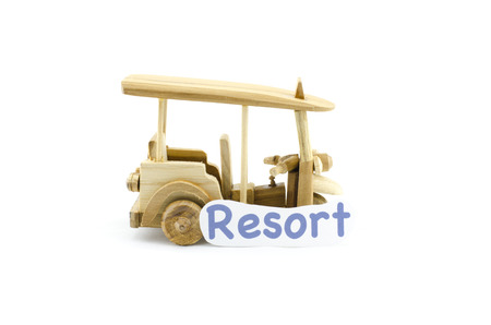 tuktuk: handcrafted souvenir.thailand iconic transport,tuk-tuk  made from wood with word resort isolated white background
