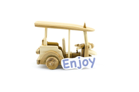 tuktuk: handcrafted souvenir.thailand iconic transport,tuk-tuk  made from wood with word enjoy isolated white background