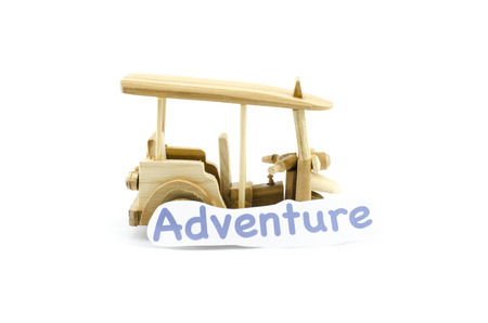 handcrafted: handcrafted souvenir.thailand iconic transport,tuk-tuk  made from wood with word adventure isolated white background Stock Photo