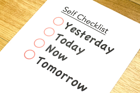 satisfactory: vertical view self checklist printed on paper and placed on brown wooden floor