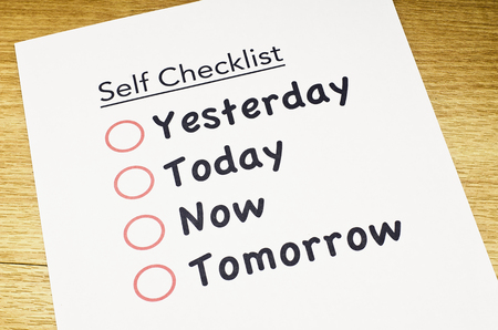 satisfactory: self checklist printed on paper and placed on wooden floor