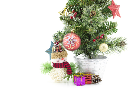 fabrick: closeup and cropped  image of christmas tree  with santa claus , gift box, red ball,pinecone and golden ball isolated on white background