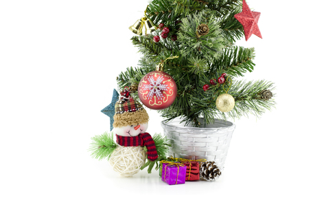 fabrick: closeup and cropped  image of christmas tree  with santa claus , gift box, red ball isolated on white background