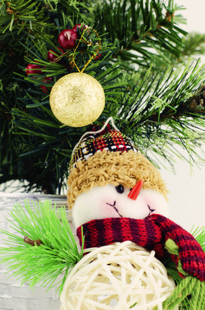 fabrick: horizontal view closeup image of santa claus, golden ball, purple gift box,  and christmas tree isolated on white background Stock Photo