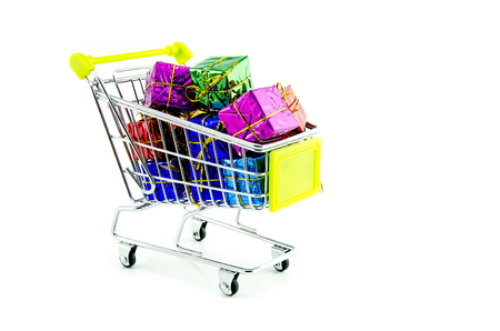 product box: Shopping trolley with colorful Christmas gifts and presents, isolated on white background
