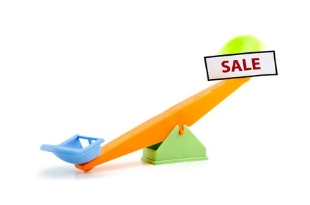rising prices: image concept unbalance seesaw with word SALE printed with red ink on white paper attach to the seesaw, isolated on white background