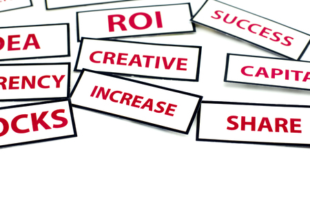 vision loss: business motivation word  IDEA, ROI, CURRENCY, CREATIVE, STOCKS and INCREASE printed on paper with red color isolated on white background