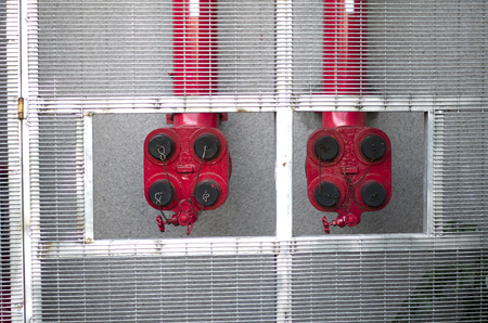 sprinkler alarm: main supply, red fire sprinklers for building placed at outdoor Stock Photo