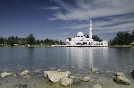 beautiful iconic  floating mosque at Terengganu, Malaysia with blue sky background. image taken . Copyspace to the left