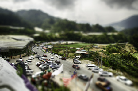 tilt view: tilt shift effect from aerial view image of cameron highland,malaysia, hill and cloudy sky background Editorial