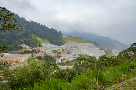 spillway: Hydroelectric dam under construction, surrounded by cloudy sky and fog background
