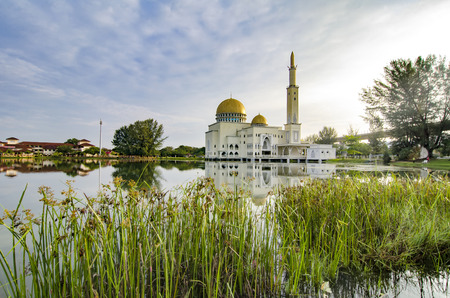 Beautiful morning scenery of As-Salam Mosque located in Selangor, Malaysia with reflecton on the lake.