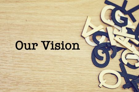 our: conceptual image, word OUR VISION on wooden background.  alphabet word on the right
