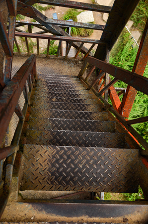 metallic stairs: rusty and old looking tower staircase Stock Photo