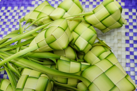 compressed rice: Ketupat or Dumpling Rice. A rice is cook in natural casing made from young coconut leaves. most iconic food during Eid Mubarak Celebration in Malaysia. Selective focus shot