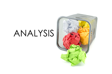 paperless: conceptual image of green, red and yellow waste color paper with word ANALYSIS. isolated white background