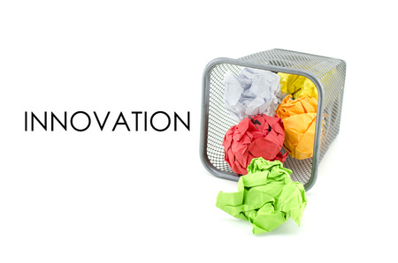 paperless: conceptual image of green, red and yellow waste color paper with word INNOVATION. isolated white background
