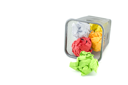 paperless: conceptual image of green, red and yellow waste color paper. isolated white background