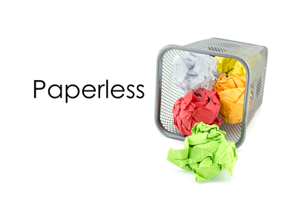 paperless: conceptual image of green, red and yellow waste color paper with word PAPERLESS. isolated white background Stock Photo