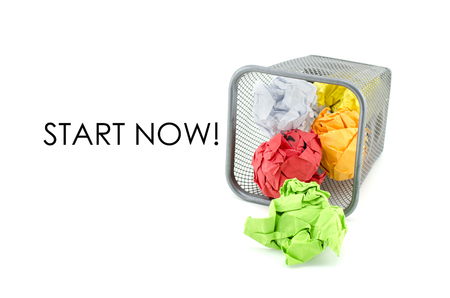 conceptual image of green, red and yellow waste color paper with word START NOW. isolated white background