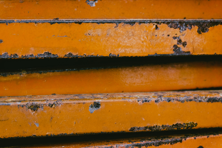 ferrous: closed up stacks of rusty stainless rectangular pipe bar background.faded effect and selective focus