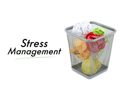 to thrash: conceptual image with word STRESS MANAGEMENT over crumple paper in metal dustbin and isolated white background