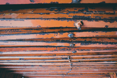 closed up stacks of rusty stainless table stands background.faded effect and selective focus