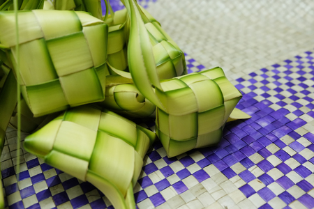 compressed rice: Ketupat or Dumpling Rice. A rice is cook in natural casing made from young coconut leaves. most iconic food during Eid Mubarak Celebration in Malaysia.