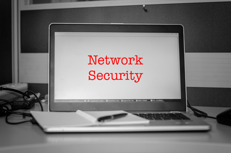 exploit: cyber security concept. red word network security display on laptop screen.Black and white image and selective focus