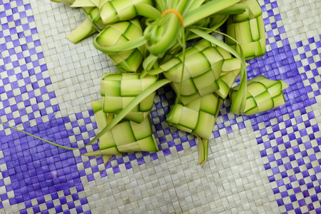 Ketupat or Dumpling Rice. A rice is cook in natural casing made from young coconut leaves. most iconic food during Eid Mubarak Celebration in Malaysia.
